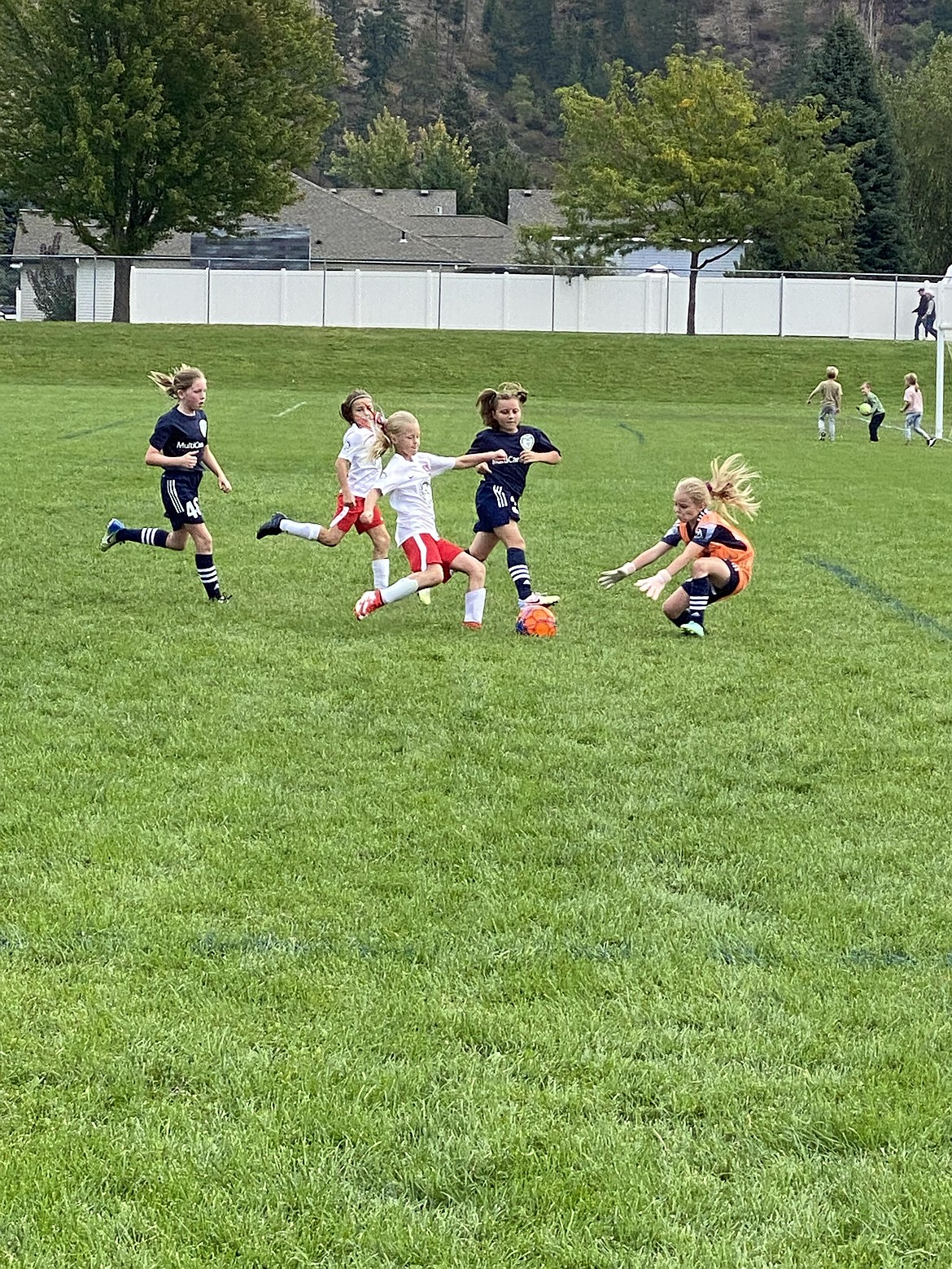 Photo by BRITNEY NUSSER The Thorns North FC 2011 girls yellow soccer team beat the Spokane Scotties 2-0 at the Dwight Merkel Sports Complex in Spokane on Saturday. Brightyn Gatten and Aubrey Sargent each scored one goal for the Thorns. Pictured in white is Brightyn Gatten closing in on the keeper, with teammate Hailey Viaud to her left.
