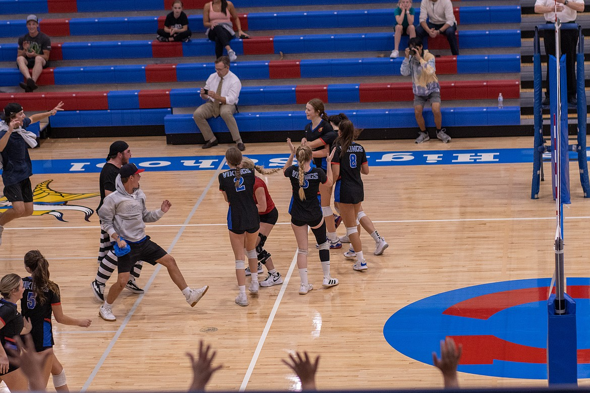 Photo by JERRY VICK Coeur d'Alene High students rush the court to celebrate with the players after Coeur d'Alene rallied from two sets down to beat Lake City on Tuesday night at Coeur d'Alene High's Viking Court.