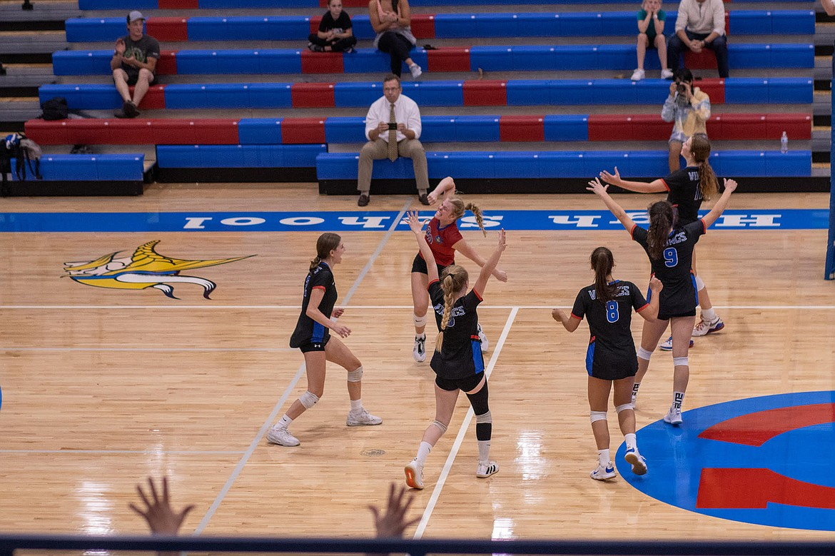 Photo by JERRY VICK Coeur d'Alene High players celebrate after beating Lake City on Tuesday night at Coeur d'Alene High's Viking Court.