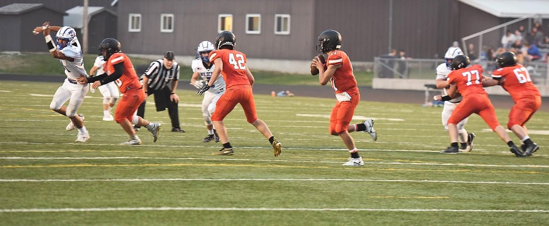 Ronan junior quarterback Caleb Cheff (11) rolls out against the Columbia Falls defense. (Scot Heisel/Lake County Leader)