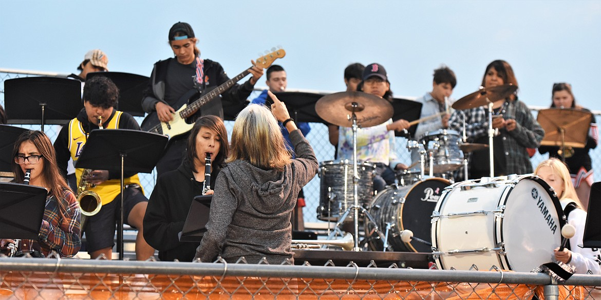 Alicia Lipscomb directs the Ronan High School band during Friday's game. (Scot Heisel/Lake County Leader)