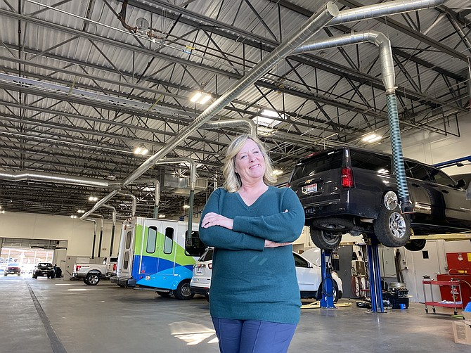 Eve Knudtsen, owner of Knudtsen Chevrolet, stands in front of the service department.