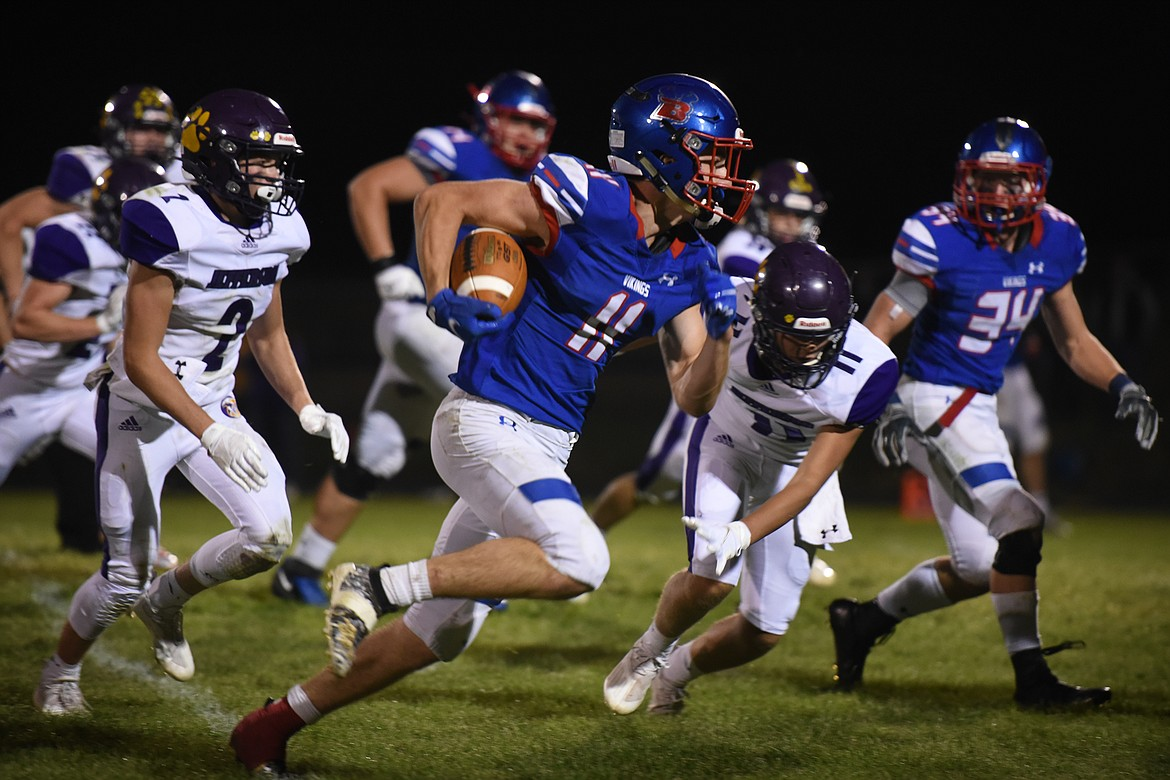 Viking George Bucklin outruns the Jefferson defense on his way to a 46-yard touchdown in the fourth quarter Friday. (Jeremy Weber/Bigfork Eagle)