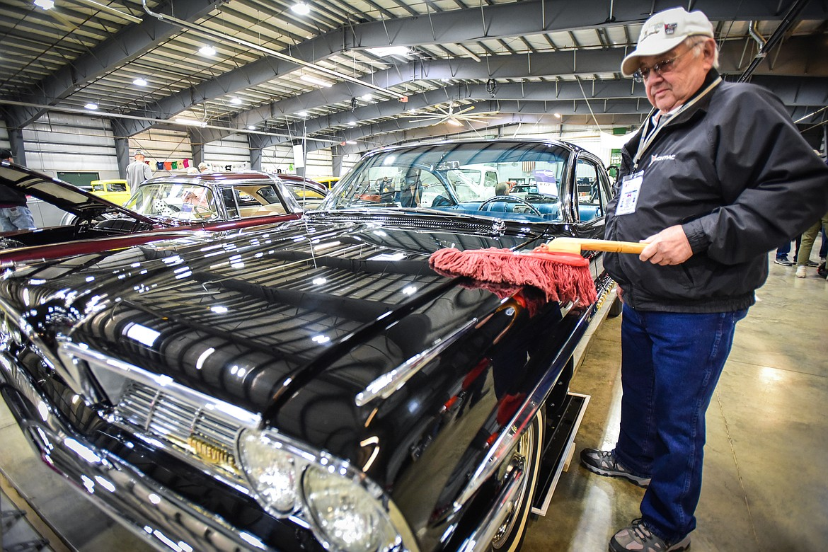 Richard Ebert, from Cut Bank, polishes his 1961 Pontiac Bonneville Super Duty at the Glacier Street Rod Association's 40th annual car show at the Flathead County Fairgrounds on Saturday, Oct. 9. (Casey Kreider/Daily Inter Lake)