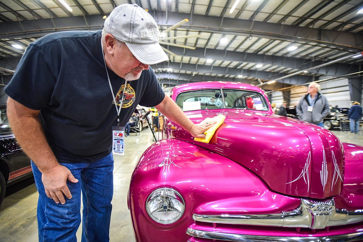 Dave Maxwell polishes the hood of a 1947 Ford Coupe at the Glacier Street Rod Association's 40th annual car show at the Flathead County Fairgrounds on Saturday, Oct. 9. (Casey Kreider/Daily Inter Lake)