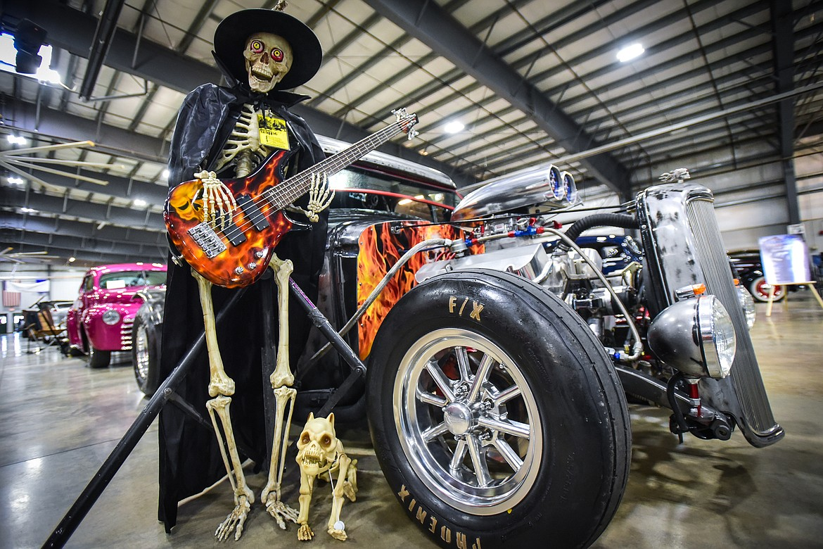 A skeletal Halloween display outside a car at the Glacier Street Rod Association's 40th annual car show at the Flathead County Fairgrounds on Saturday, Oct. 9. (Casey Kreider/Daily Inter Lake)