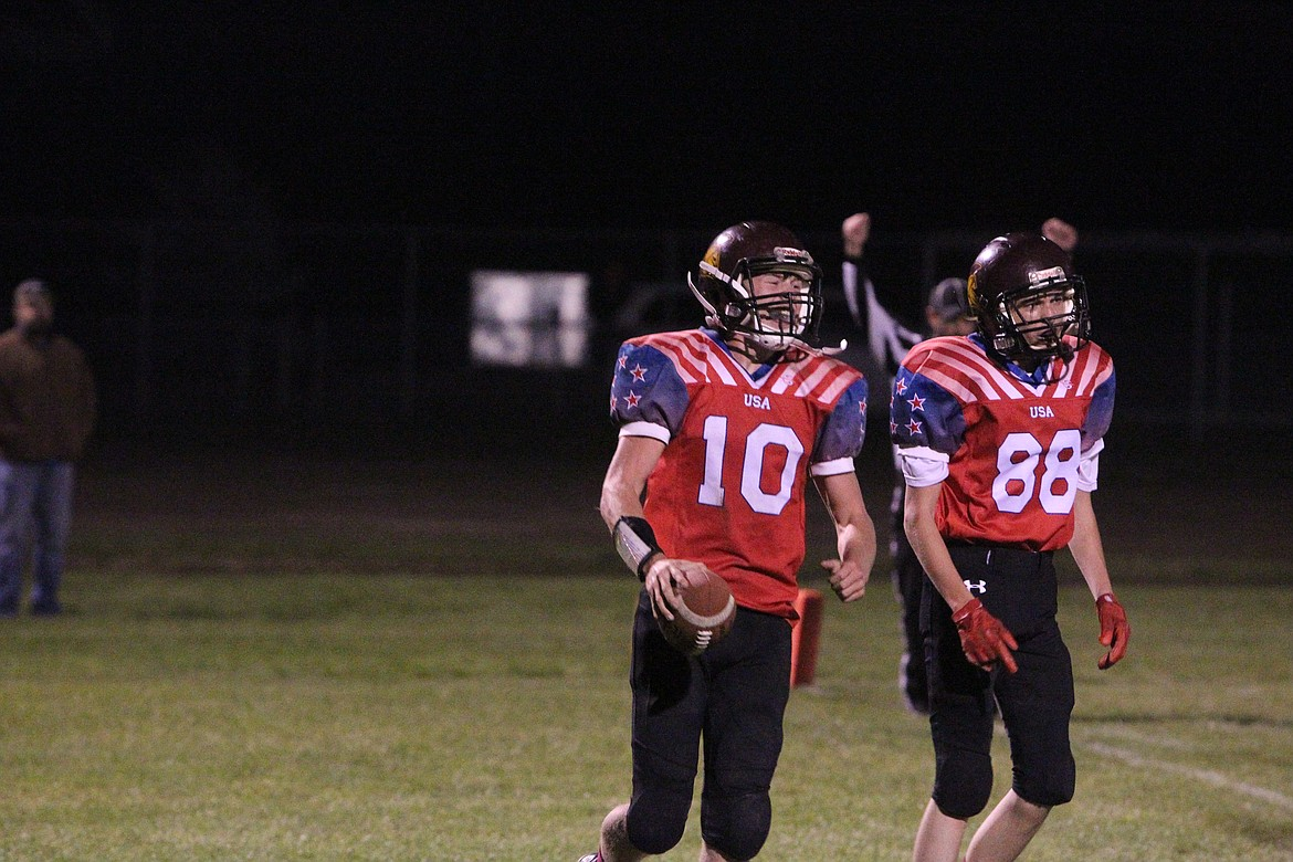 Troy quarterback Trevor Grant, left, and wide receiver Kempton Sloan celebrate after a Trojan touchdown during an Oct. 8 game against Plains. (Will Langhorne/The Western News)