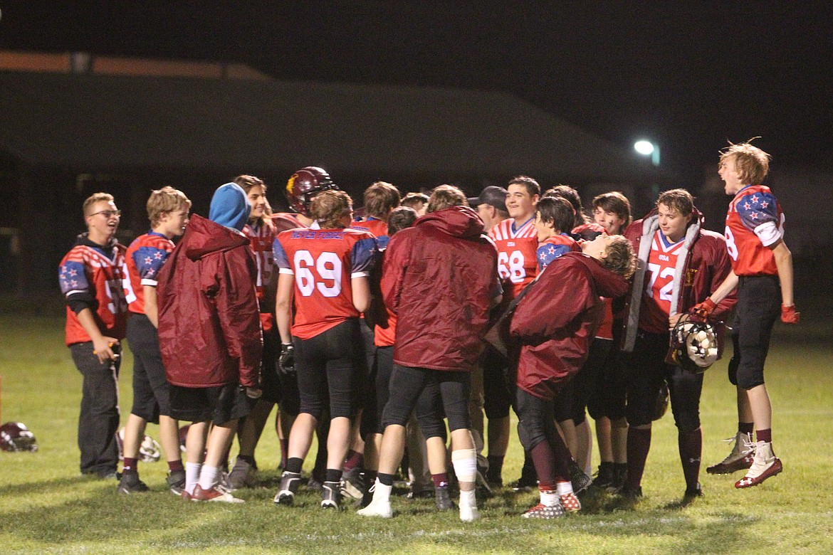 Trojans celebrate following their Oct. 7 victory against Plains. (Will Langhorne/The Western News)