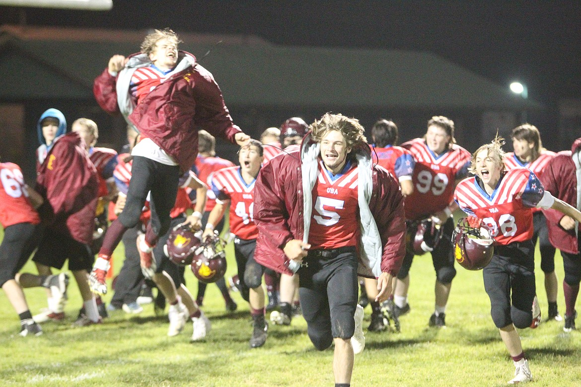 Trojans celebrate following their Oct. 7 win against Plains. (Will Langhorne/The Western News)