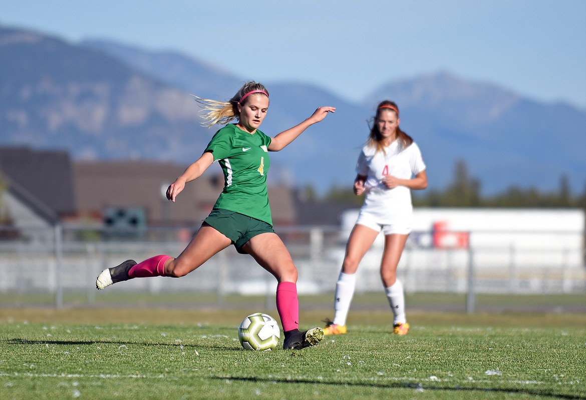 Bulldog Sophie Olson winds up to advance the ball up the field during a game in Whitefish on Thursday. (Whitney England/Whitefish Pilot)