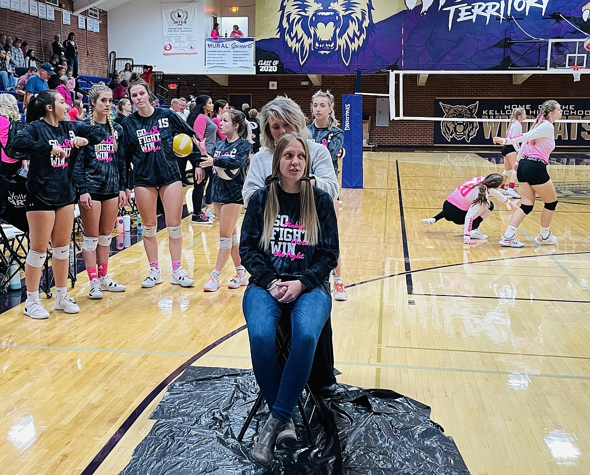 Kellogg High School Volleyball Coach Steph Batchelder gets her hair cut so she can donate it for the creation of a wig.