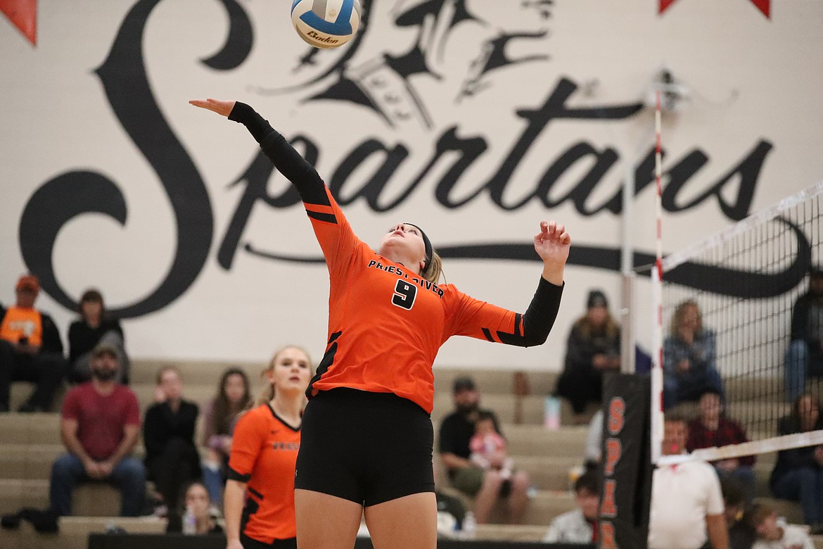 Allyson Barton attempts to tip a ball over the net last Wednesday.