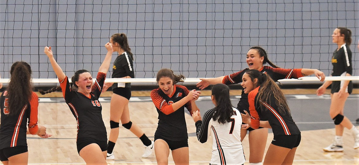 Ronan players celebrate a point against Polson. (Scot Heisel/Lake County Leader)