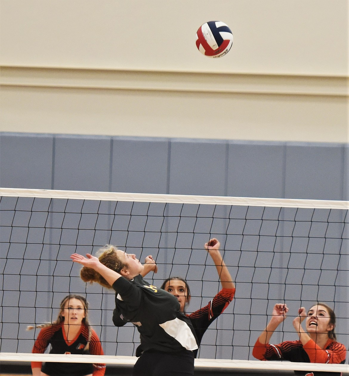 Polson's Camilla Foresti rises for a shot against the defense of Hannah Rowe (4), Leina Ulutoa, center, and Olivia Clairmont. (Scot Heisel/Lake County Leader)